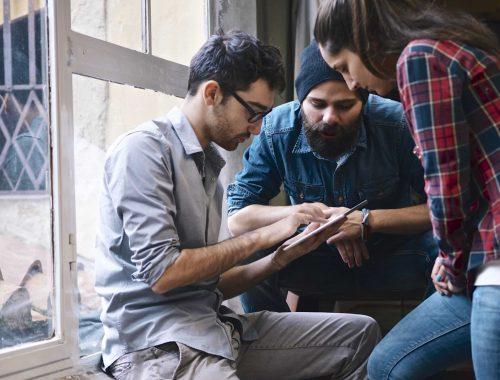 group of university students studying back to school | website development Las Vegas